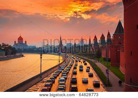 Traffic at sunset near Kremlin wall in Moscow, Russia.
