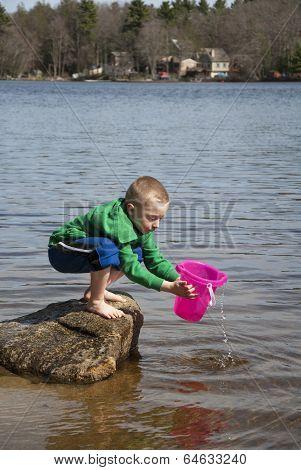 Boy Hauling Water