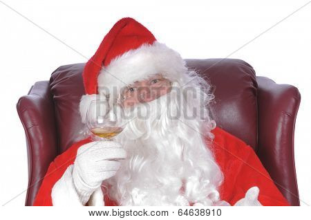 Santa enjoying a rest after a nights work, with a small libation
