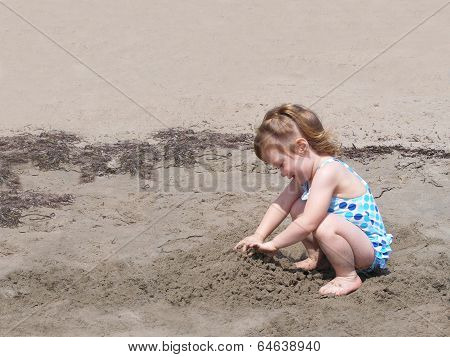 Child Playng In Beach Sand