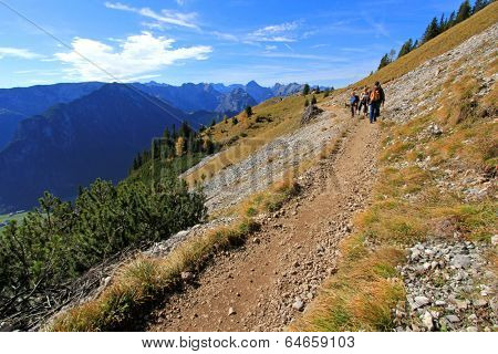 ROFAN, AUSTRIA -  OCTOBER 2013 : People trekking at the Dalfazalm Alpine pasture at 1693 m. high on October 26, 2013 in Rofan, Austria.