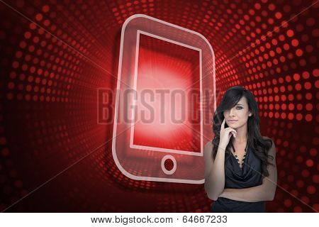 Composite image of tablet pc and sexy brunette against red pixel spiral