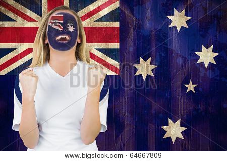 Excited australia fan in face paint cheering against australia flag in grunge effect poster