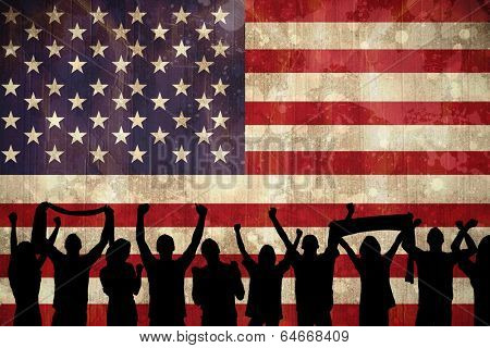Silhouettes of football supporters against usa flag in grunge effect poster