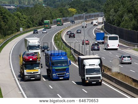 trucks on a three-lane motorway. symbolic photo for transport of goods