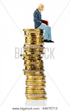 pensioners sitting on money stack, symbol photo for retirement and old-age security