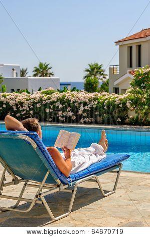 Man Read Book On Deck Chair