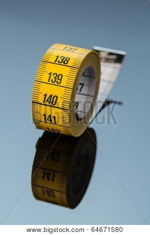 yellow tape measure, symbolic photo for diet control and precision
