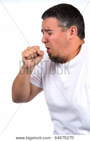 Sick adult male coughs into his fist. poster