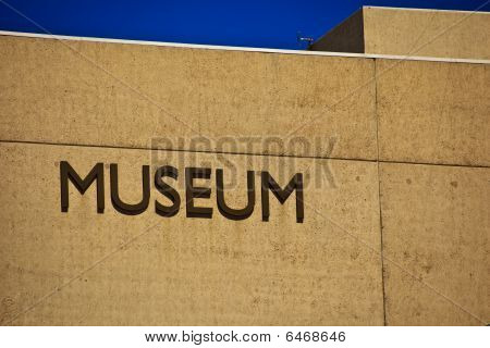 Sign That Says Museum on the Side of a Building