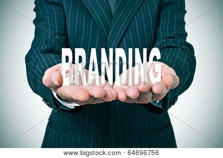 man wearing a suit with the word branding in his hands