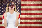 Excited fan in usa face paint cheering against usa flag in grunge effect poster