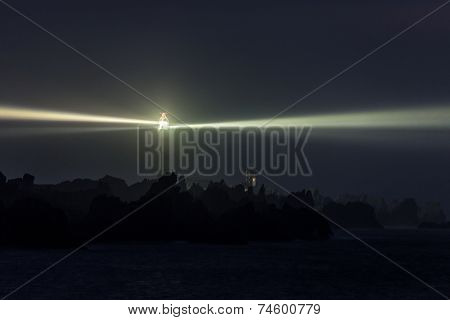 Lighted very powerful lighthouse in full night