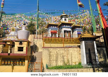 Colorful buddhist prayer flags in town of Dharamshala Himachal Pradesh India poster