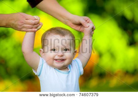Smiling Happy Baby Learning To Walk Outdoors