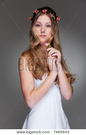Graceful Young Woman With Flowers