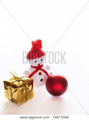 Snowman, package and Christmas ball on white background