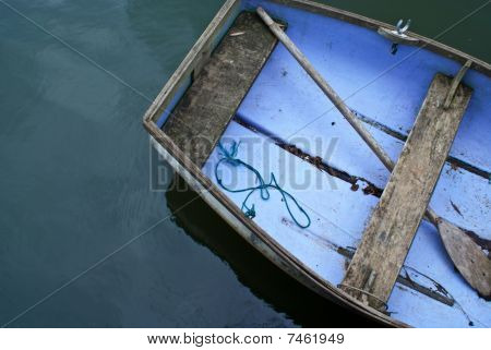 A Portion Of An Aged Rowboat On The Water Taken From Above