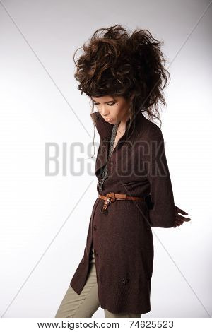 Glamorous Woman In Brown Jacket Looking Down