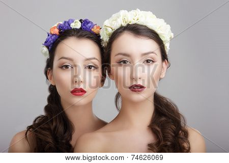 Elegance. Two Women With Wreaths Of Flowers. Fantasy