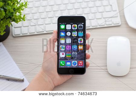 Woman Holding Iphone 6 Space Gray Over The Table