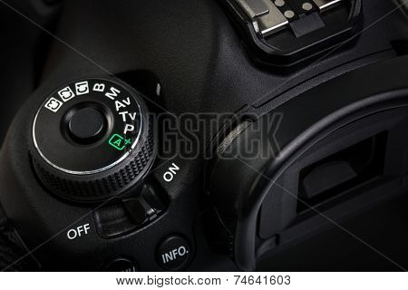 Professional modern DSLR camera - detail of the top LCD with settings - shutter speer, aperture, ISO, AF mode, battery info, RAW format indication,...