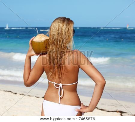 Woman Holding Coconut On The Beach
