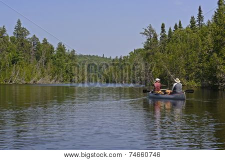 Canoers Heading Into A North Woods Lake