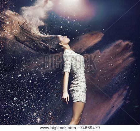 Fine art photo of a beautiful girl dancing