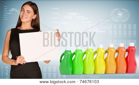 Businesswoman and several multi-colored bottles with household chemicals