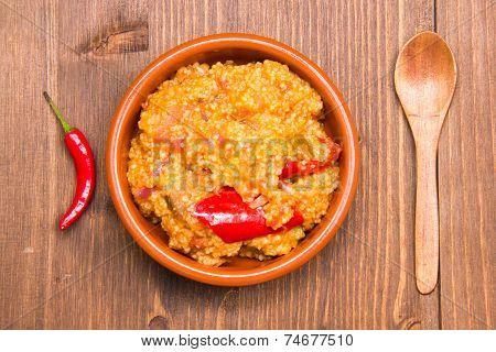 Couscous with vegetables on wood from above