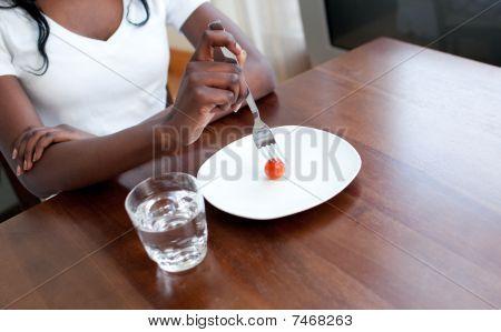 Teen Girl Eating A Tomato