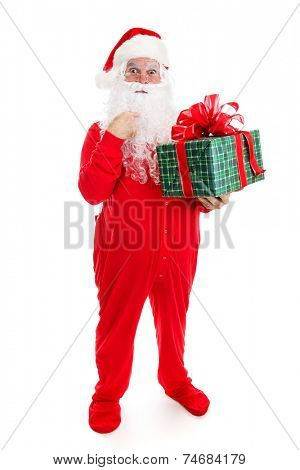 Santa Claus in his pajamas, surprised by a Christmas gift for him.  Full body isolated.