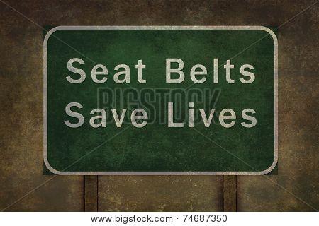 Seat belts save lives roadside sign