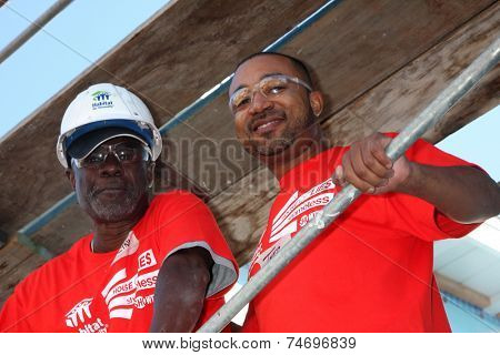 LOS ANGELES - OCT 25:  Glynn Turman, Theo Travers at the Habitat for Humanity build by Showtime's