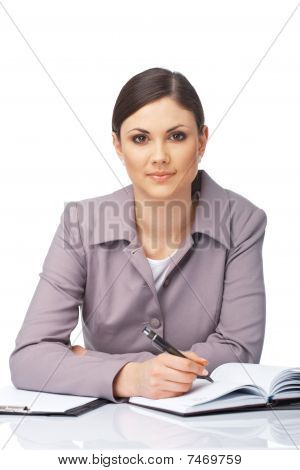 Businesswoman Writing In Her Diary.