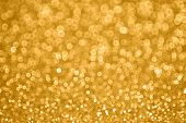 A gold and sparkle and glitter background poster
