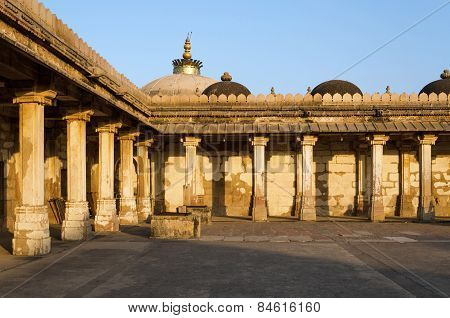 Colonnaded of historic Tomb of Mehmud Begada Sultan of Gujarat at Sarkhej Roza mosque in Ahmedabad India poster