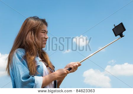 Beauty Women Use Monopod Stick Selfie Photography In Bright Day