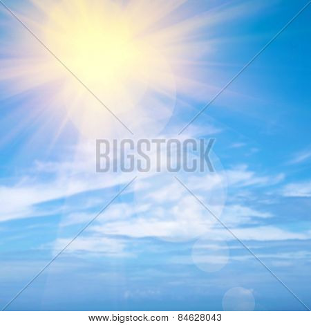 Heavenly blue sky with bright sunshine and light beams
