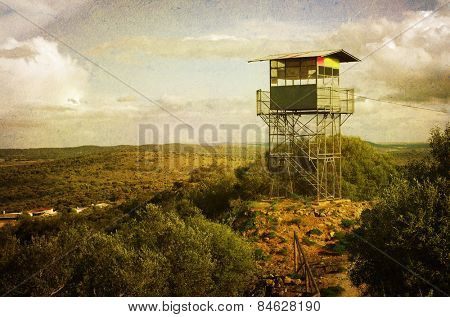 vintage style image of observation tower to prevent fire in the hills