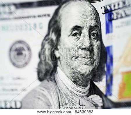 Portrait of Benjamin Franklin from one hundred dollars bill new edition closeup conceptual background poster