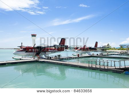 MALE, MALDIVES - SEPTEMBER 07 2008: Twin otter red seaplane Hydroplane at Male airport poster
