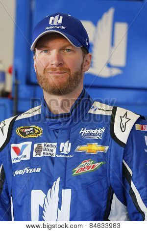 Daytona Beach, FL - Feb 15, 2015:  Dale Earnhardt Jr. (88) watches qualifying for the Daytona 500 at Daytona International Speedway in Daytona Beach, FL.