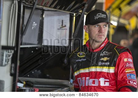 Daytona Beach, FL - Feb 14, 2015:  Michael Annett (46) watches his crew make adjustments to his car for the Daytona 500 at Daytona International Speedway in Daytona Beach, FL.