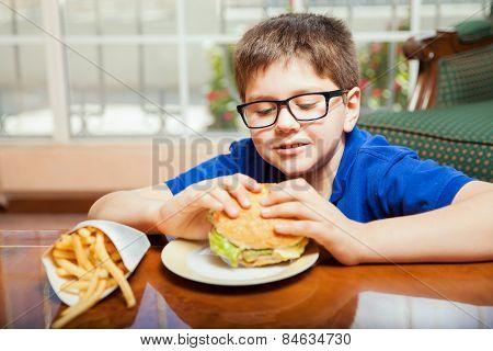 Kid Eating A Hamburger