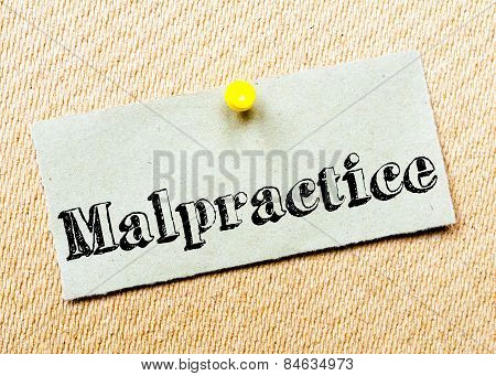 Recycled Paper Note Pinned On Cork Board. Malpractice Message. Concept Image