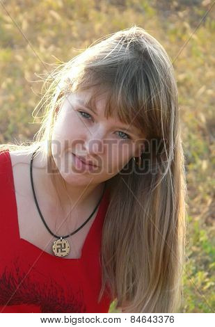 Girl with slavic pagan swastika (religious symbol)