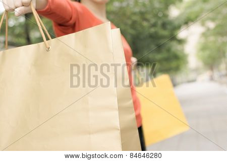 Shopping woman feel free in Xinyi district, the business and commercial center in Taipei, Taiwan, Asia. Closeup image focus on bags.