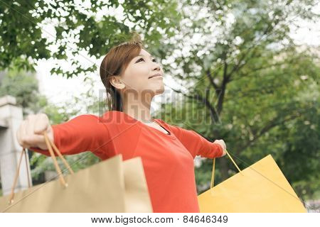 Shopping woman feel free in Xinyi district, the business and commercial center in Taipei, Taiwan, Asia.